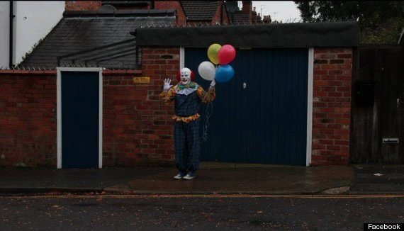 Picture of a Pennywise look-a-like clown loitering on the streets of an English town.