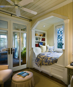 I am extremely envious of the owner of this book reading nook with shelving, a day bed, and a window.