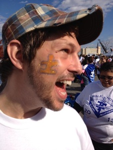 Nick with an Autism Awareness puzzle piece painted on.