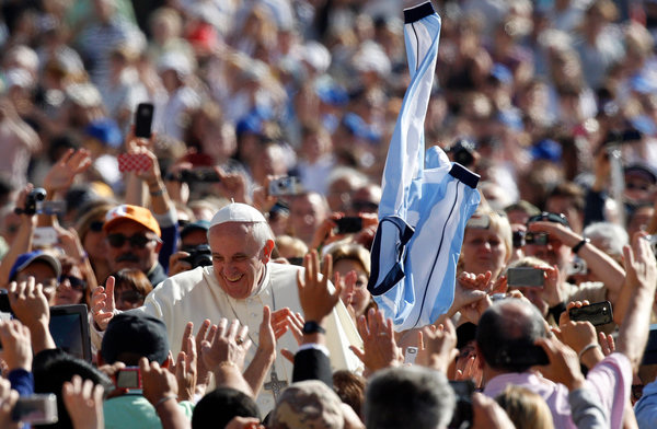 Picture of Pope Francis in a crowd of people.